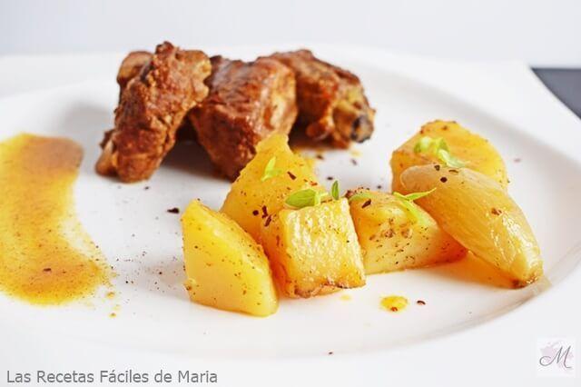 Costillas adobadas con patatas al horno